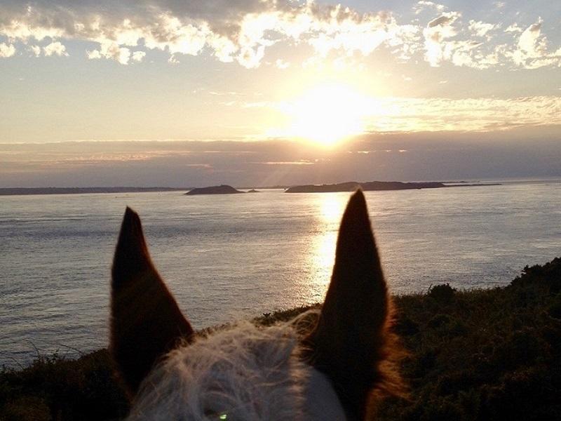 Sunset from L'Epequerie whilst on horseback. Herm, Jethou & Guernsey in the background